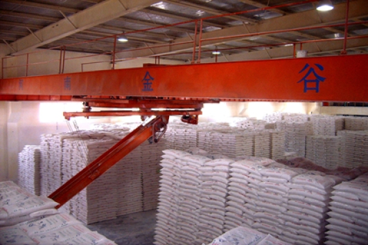 Crane type bag stacker